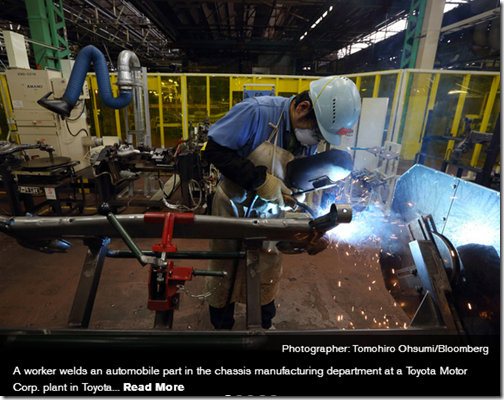 A worker welds an automobile part in the chassis manufacturing department at a Toyota Motor Corp. plant in Toyota City.